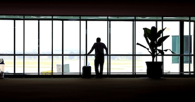 silhouette-man-standing-airport-plane-260nw-1036929754